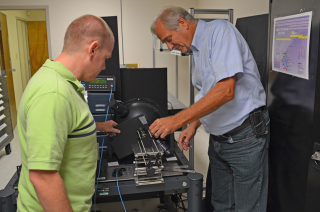 Gary Evans and Dale Cull setting up an experiment in the optics lab